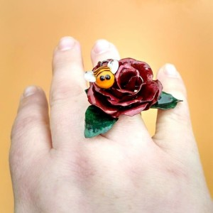 Sterling, copper, glass, prismacolor and resin bee ring, size 7.5/8. Available, please inquire
